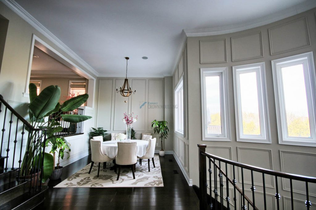 luxury living room crown moulding and wainscoting