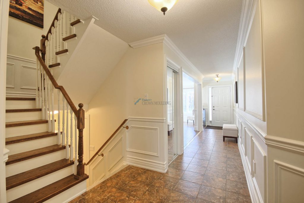 stairway with wainscoting panels and woodwork