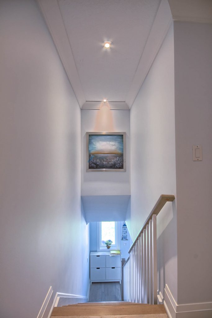 moulding and pot lights stairs design