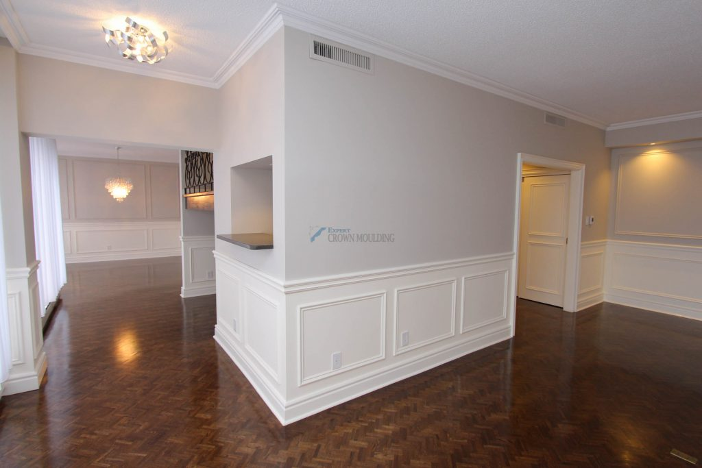renovated appartment with crown moulding and wainscoting