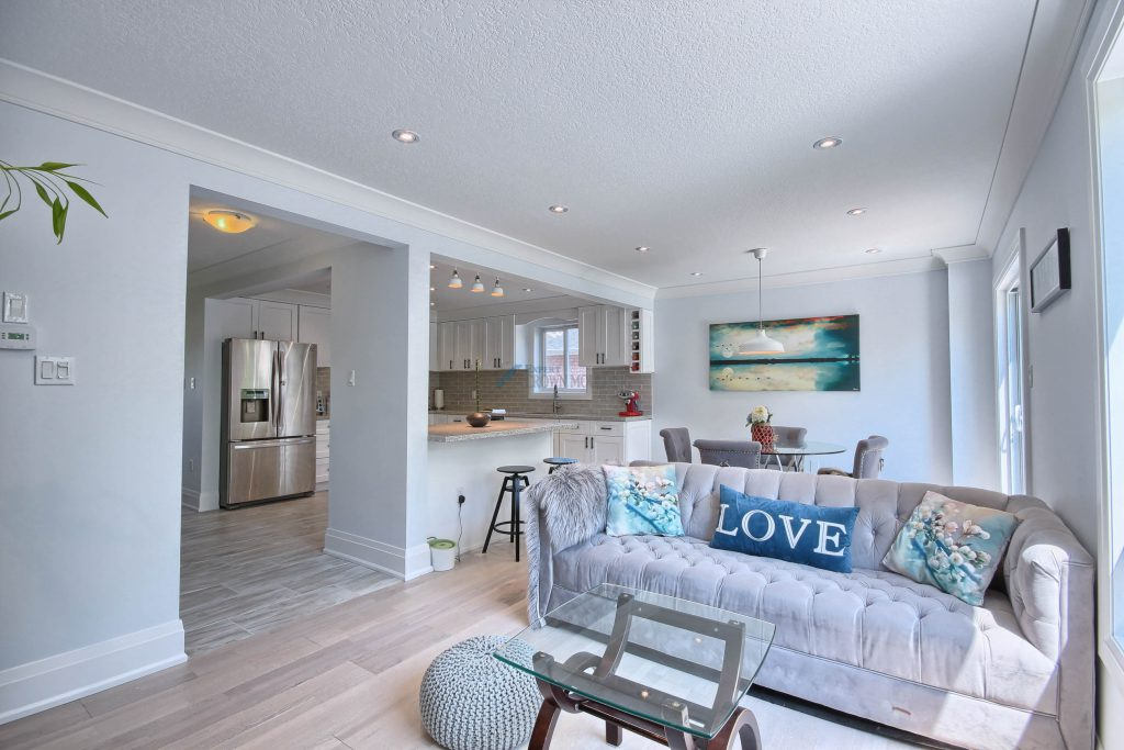 living room with pot lights and crown mouldings