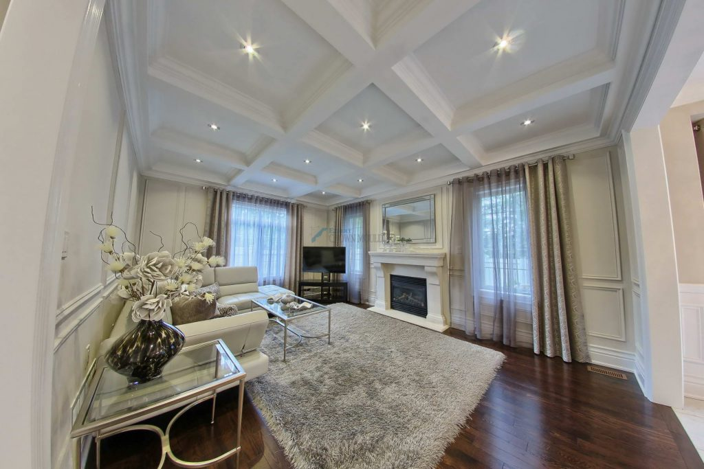 full wainscoting and coffered ceiling