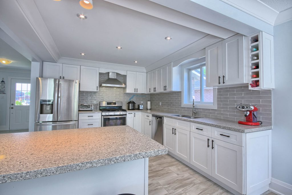 large kitchen interior with tray ceiling crown moulding